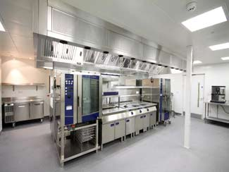 Island cooking range and ventilation canopy in corporate office