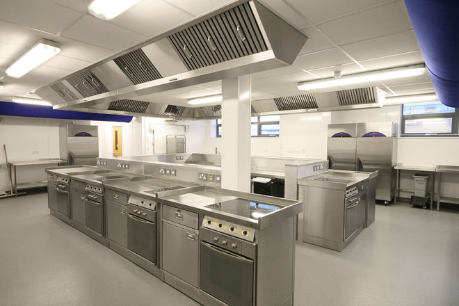 Island cooking range and ventilation canopy in corporate office & KM Services - Photography - 1